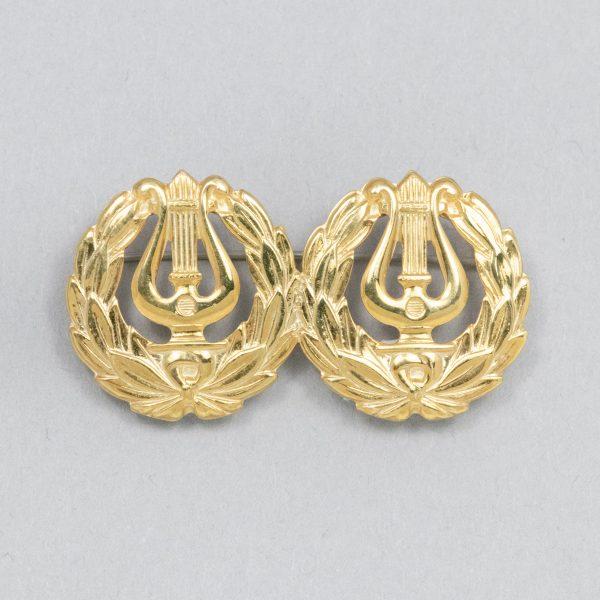 Suomalainen kaksoisäidinlyyra, kultaa